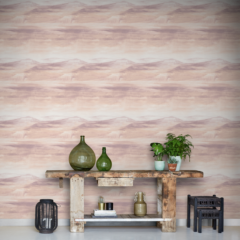 Pink wallpaper combines well with wooden elements and sleek and light furniture.
